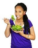 Ragazza che mangia insalata Fotografia Stock