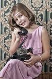 Retro telefonata della ragazza Fotografia Stock