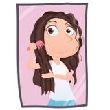 Ragazza che pettina capelli Fotografia Stock