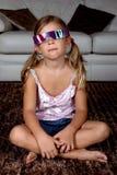 Ragazza che porta i vetri 3D Fotografie Stock