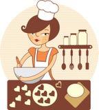 Ragazza che produce i biscotti Fotografia Stock