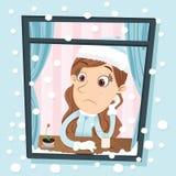 Ragazza che si siede vicino alla finestra il giorno della neve Fotografie Stock Libere da Diritti
