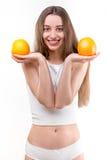 Ragazza che sorride con le arance Immagini Stock Libere da Diritti