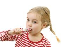 Ragazza che succhia lollipop Fotografia Stock Libera da Diritti