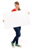 Ragazza che tiene manifesto in bianco Fotografia Stock
