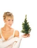 Ragazza che tiene un albero di Natale Immagine Stock Libera da Diritti