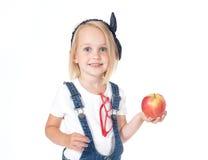Ragazza che tiene una mela Fotografie Stock
