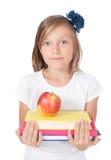 Ragazza che tiene una mela Fotografia Stock