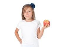 Ragazza che tiene una mela Fotografia Stock Libera da Diritti