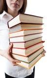 Ragazza che tiene una pila di libri Fotografie Stock