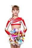 Ragazza Cheerleading che sta con il pom fotografie stock