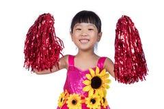 Ragazza cinese asiatica della ragazza pon pon che tiene un pompon Immagine Stock Libera da Diritti