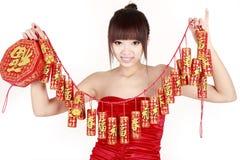 Ragazza cinese durante il nuovo anno. Fotografie Stock Libere da Diritti