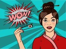 Ragazza cinese in Pop art Una giovane donna sta tenendo i sushi con i bastoncini Immagini Stock