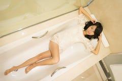 Ragazza cinese sexy in un boudoir Fotografie Stock Libere da Diritti