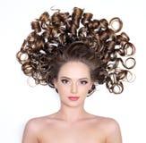 Ragazza con capelli ricci Immagini Stock Libere da Diritti