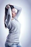 Ragazza con capelli in su Fotografia Stock