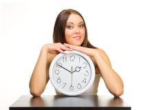 Ragazza con gli orologi Immagini Stock