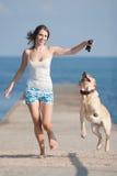 Ragazza con i cani Fotografie Stock