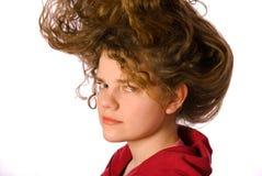 Ragazza con i capelli ricci lunghi Fotografia Stock