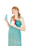 Ragazza con i contenitori cosmetici Fotografie Stock