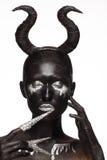 Ragazza con i corni sul suo testa Fotografia Stock Libera da Diritti