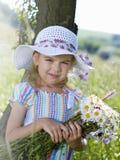 Ragazza con i fiori Fotografie Stock
