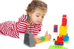 Ragazza con i giocattoli Fotografia Stock
