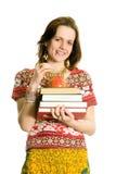 Ragazza con i libri e la mela. Isolato su bianco. Immagini Stock Libere da Diritti