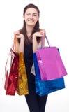 Ragazza con i loro acquisti. Immagini Stock Libere da Diritti