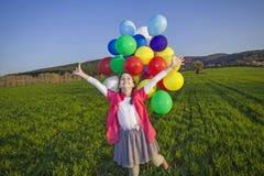 Ragazza con i palloni Immagini Stock Libere da Diritti