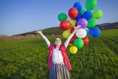 Ragazza con i palloni Fotografia Stock