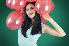 Ragazza con i palloni rossi Fotografie Stock