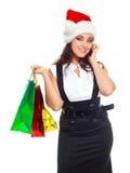 Ragazza con i sacchetti che comunica sul telefono Immagine Stock