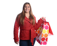 Ragazza con i sacchetti della spesa Immagini Stock