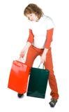 Ragazza con i sacchi di carta fotografia stock libera da diritti