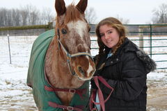 Ragazza con il cavallo Fotografia Stock