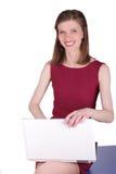 Ragazza con il computer portatile Fotografie Stock