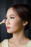Ragazza con il cosmetico Fotografie Stock