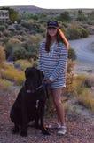 Ragazza con il cucciolo di great dane Fotografie Stock
