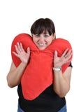 Ragazza con il cuscino del cuore Fotografia Stock