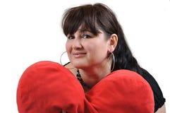 Ragazza con il cuscino del cuore Fotografia Stock Libera da Diritti