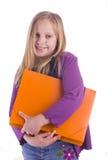 Ragazza con il dispositivo di piegatura arancione Fotografie Stock