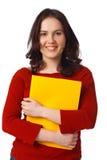 Ragazza con il dispositivo di piegatura giallo Fotografie Stock Libere da Diritti