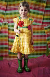 Ragazza con il fiore ed i caricamenti del sistema Fotografia Stock Libera da Diritti
