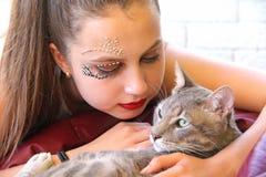 Ragazza con il gatto Immagini Stock
