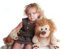 Ragazza con il giocattolo Fotografia Stock