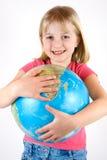 Ragazza con il globo immagini stock