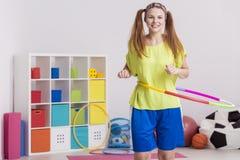 Ragazza con il hula-hoop Fotografia Stock