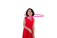 Ragazza con il hula-hoop sul suo collo Immagini Stock Libere da Diritti